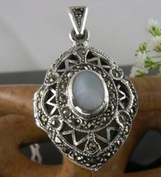 Silver and Marcasite Locket with inset Mother of Pearl