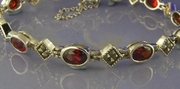 Elegant Silver and Marcasite Bracelet with Garnet