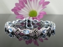 Elegant Silver and Marcasite Bracelet with Blue Topaz